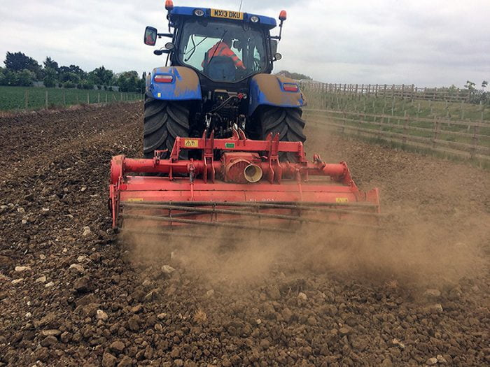 Land restoration tractor in action